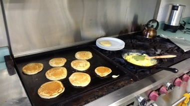 Pancakes and eggs in the professional kitchen at the church