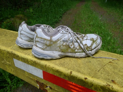Creepy shoes left on a gate at another private undeveloped road
